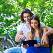 Stock Photo: Young couple on the park bench