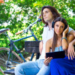 Young couple on the park bench — Stock Photo #28232825