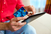 Man hand credit card and tablet — Stock Photo