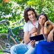 Young couple on the park bench — Stock Photo #28405051