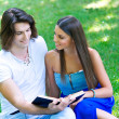 Young couple with book — Stock Photo