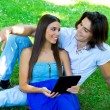 Young couple with tablet — Stock Photo