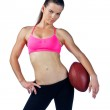 Attractive woman with football — Stock Photo #29382663