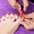 Stock Photo: Woman foot nail polishing in salon