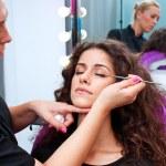 Woman putting mascara make up — Stock Photo