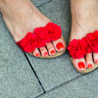 Woman feet in sandals — Stockfoto