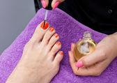 Woman foot nail polishing in salon — Stock Photo