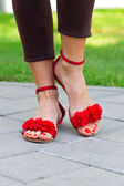 Woman feet in sandals — Stock Photo