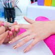 Nail polishing in manicure salon — Stock Photo
