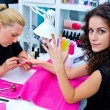 Woman with stylist on manicure — Stock Photo #29670713