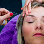 Threading hair removal procedure — Stock Photo #32040743