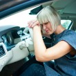 Sad womin her car — Stock Photo #32041973