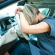 Sad woman in her car — Stock Photo
