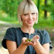 Attractive woman holding acorns outside — Stock Photo