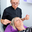 Threading hair removal — Stock Photo #32042459