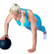 Woman working on push ups with ball — Stock Photo #32042569