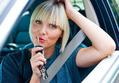Woman driver with car key — Stockfoto