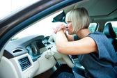 Sad woman in her car — Stock Photo