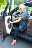 Attractive woman sitting in her car — Stock Photo