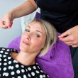 Womhaving threading hair removal procedure — Stock Photo #33218265