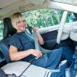 Woman driver putting safety belt — Stock Photo #33218889