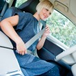 Woman driver putting safety belt — Stock Photo