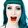 Woman with tongue in shape of german flag — Stock Photo