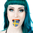Woman with sweden flag tongue — Stock Photo