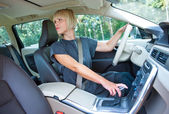 Woman driver parking her car — Stock Photo