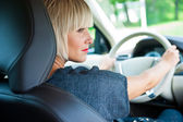 Attractive woman driver in her car — Stock Photo