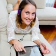 Attractive woman listen music on sofa — Stock Photo