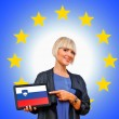 Woman holding tablet with slovenian flag on european union back — Stock Photo #33920841