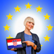 Woman holding tablet with croatian flag on european union backg — Stock Photo #33920165