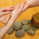 Постер, плакат: Female feet on massage spa treatment