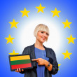 Woman holding tablet with lithuania flag on european union back — Stock Photo #33922573
