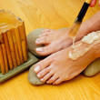 Female feet on spa treatment — Stock Photo #33924189