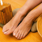 Постер, плакат: Female feet on spa treatment