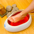 Stock Photo: Womfoot in paraffin bath at spa