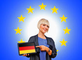 Woman holding tablet with united german on european union backg — Stok fotoğraf