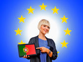 Woman holding tablet with united portugal on european union bac — Stok fotoğraf