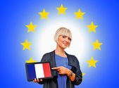 Woman holding tablet with united france on european union backg — Stok fotoğraf