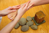 Female feet on massage spa treatment — Stock Photo