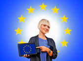 Attractive blond woman holding tablet with european flag — Stock Photo