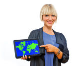 Attractive blond woman holding tablet with world map — Stock Photo