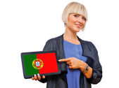 Attractive blond woman holding tablet with portugal flag — Stock Photo