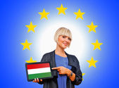 Woman holding tablet with hungary flag on european union backgr — Stock Photo
