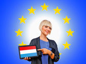 Woman holding tablet with luxembourg flag on european union bac — Stock Photo