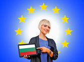 Woman holding tablet with bulgarian flag on european union back — Stok fotoğraf