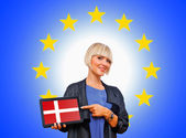 Woman holding tablet with denmark on european union background — Stock Photo