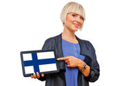 Attractive blond woman holding tablet with finland flag — Stock Photo